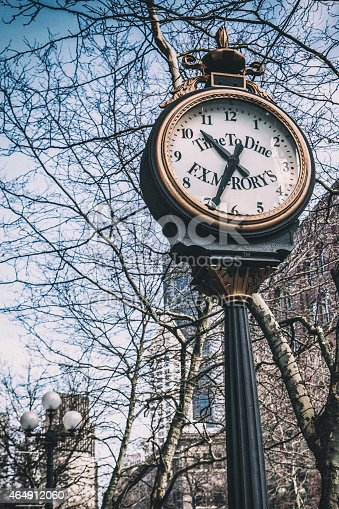 Seattle, USA - February 22, 2015: Landmark clock outside F. X. McRory's restaurant in Pioneer Square.