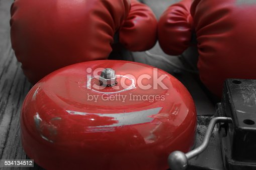 boxing gloves on plank wood , Bell and boxing gloves