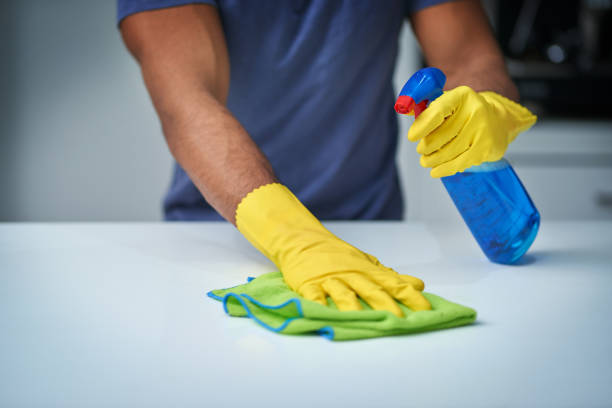 Time to get clean Shot of an unrecognizable man doing household chores cleaner stock pictures, royalty-free photos & images