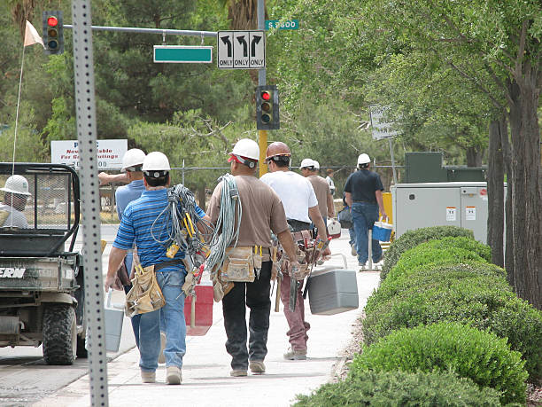 Time to go Home Workers going home after a tiring day of work. labor union stock pictures, royalty-free photos & images