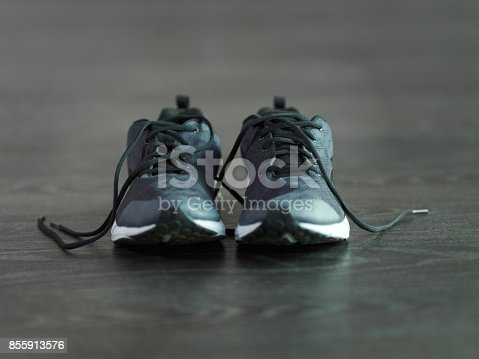 Shot of athletic footwear on the floor of a gym