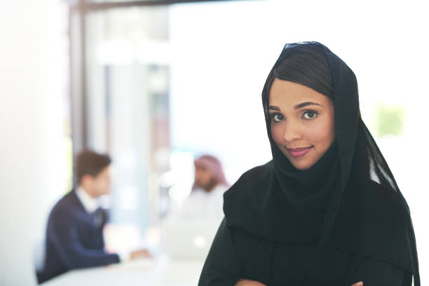 time to make it work - saudi woman stock photos and pictures