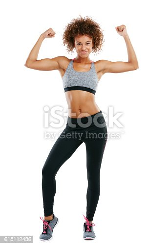 Studio shot of a fit young woman flexing her muscles against a white background