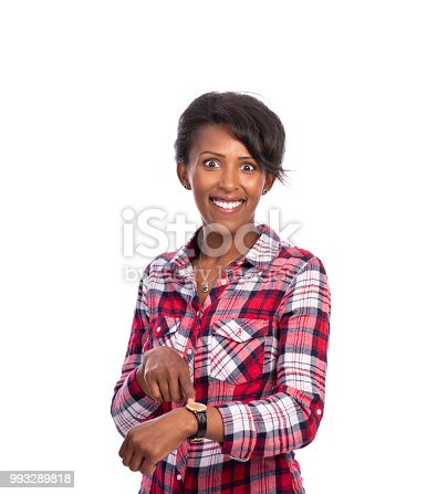 Portrait of happy woman wearing a plaid shirt, pointing over hand clock, looking at the camera with surprised at what time positive facial expression.