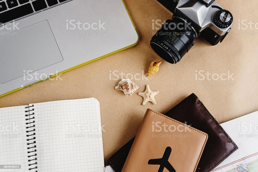time to plan travel concept, stylish passport with plane, map watch and camera on craft background - Foto stock royalty-free di Aeroplano
