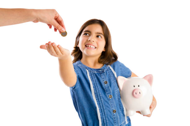 Time to savings Young girl start her savings on a piggybank allowance stock pictures, royalty-free photos & images