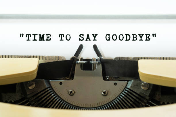time to say goodbye word typed on a yellow vintage typewritter. business concept. - disconnect stock pictures, royalty-free photos & images