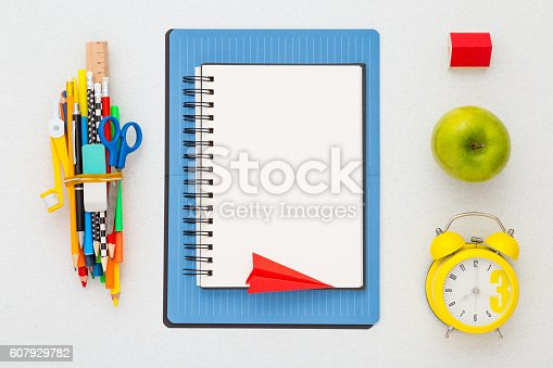 istock Time to school. School supplies on a desk. Flat lay. 607929782