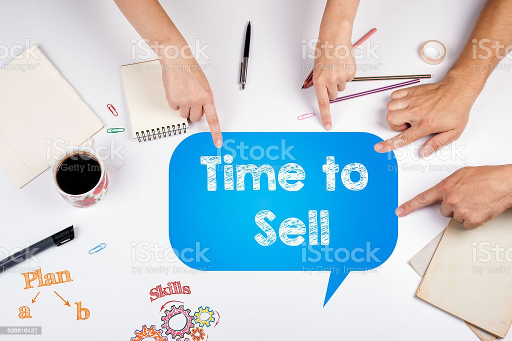 Time to Sell. The meeting at the white office table. stock photo