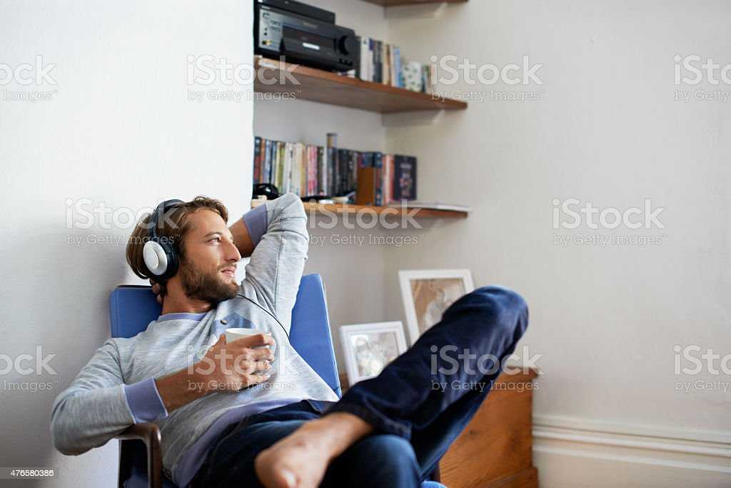 Time to unwind with some music... stock photo