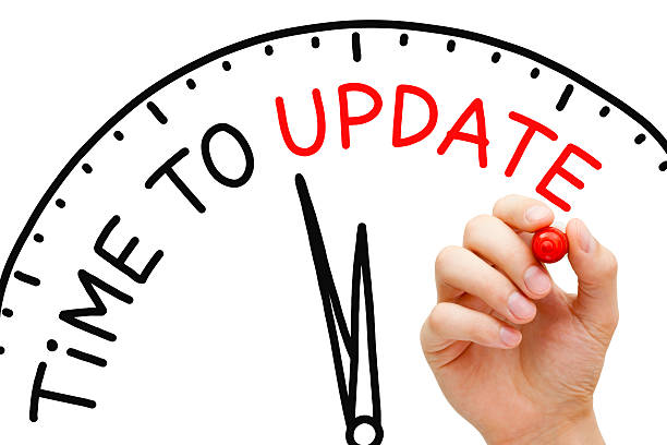 Time to Update Hand writing Time to Update concept with red marker on transparent wipe board. update communication stock pictures, royalty-free photos & images