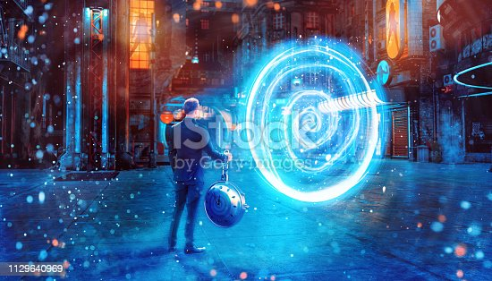 istock Time traveler holds a clock and stands in front of a portal ready get teleported to another dimension 1129640969