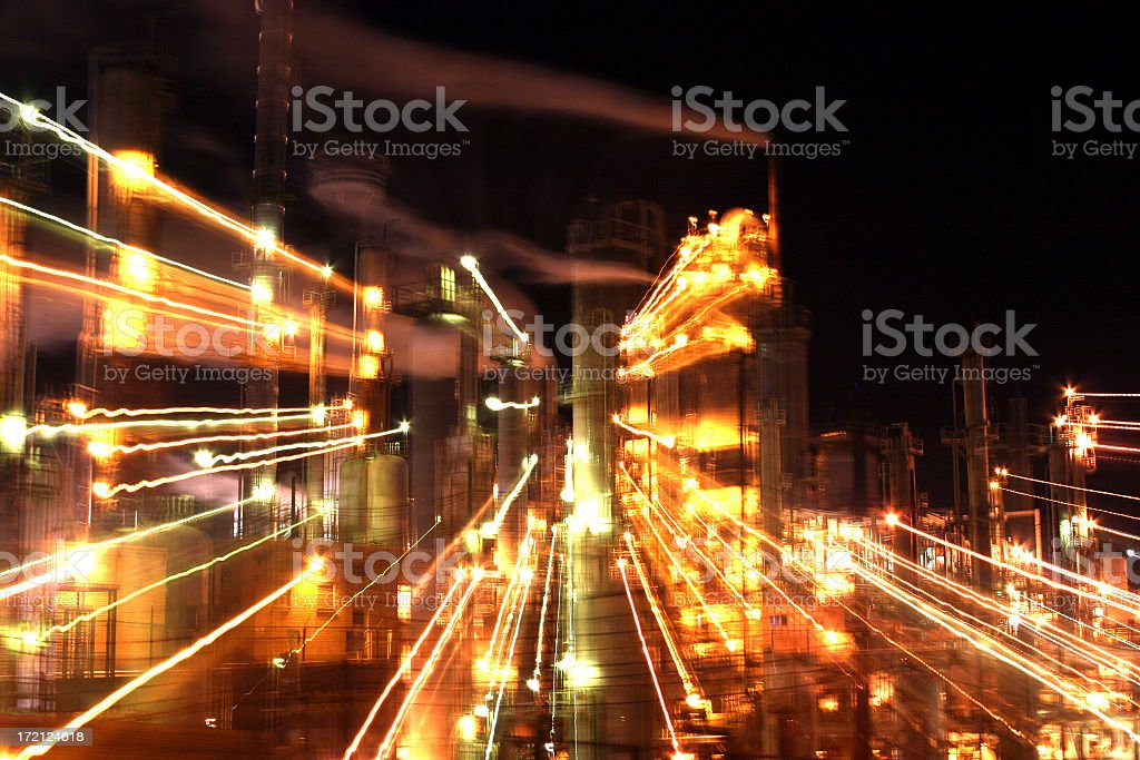 Timed exposure of refinery with a zoom royalty-free stock photo