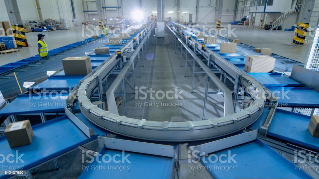 Time-Lapse of Working Large Belt Conveyor with Parcels at Sorting Post Office. stock photo