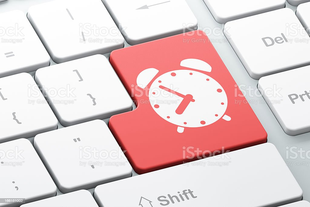 Timeline concept: Alarm Clock on computer keyboard royalty-free stock photo