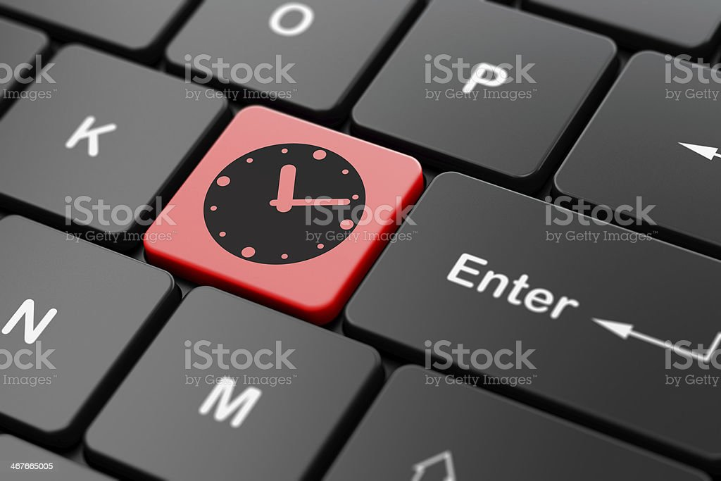 Timeline concept: Clock on computer keyboard background royalty-free stock photo