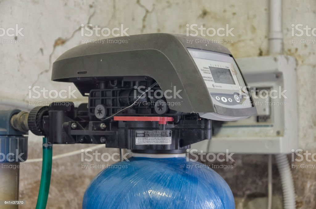 Timer and valve assembly of a water conditioner stock photo