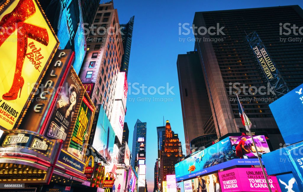 Times Square advertising illuminated at dusk - foto de acervo