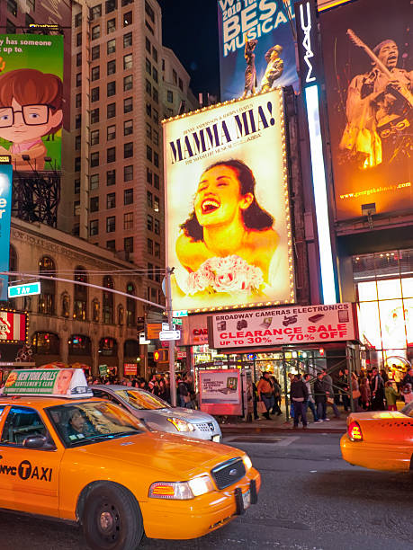 times square and theater district billboards, usa - mamma mia stock photos and pictures