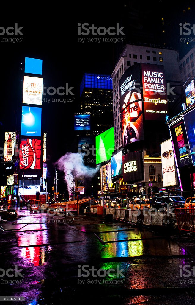 Times Square at night.  Cabs head downtown. stock photo