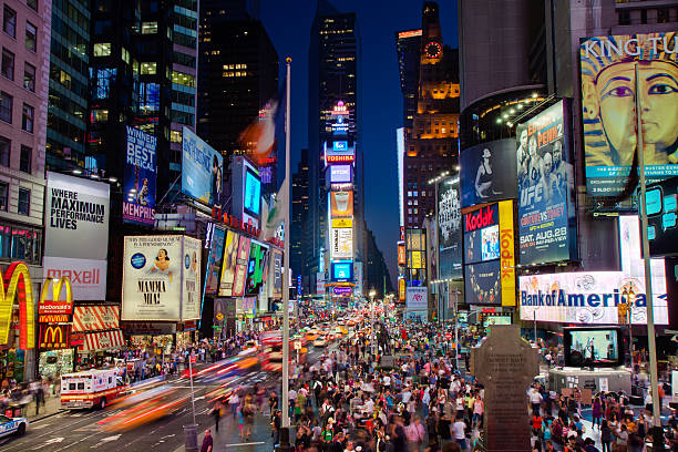 times square at night - mamma mia stock photos and pictures