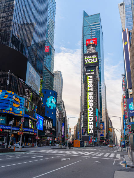 times square commercials on the main plaza display are now replaced with social advertising influenced by covid-19 pandemic outbreak, thanking first responders. - first responders стоковые фото и изображения