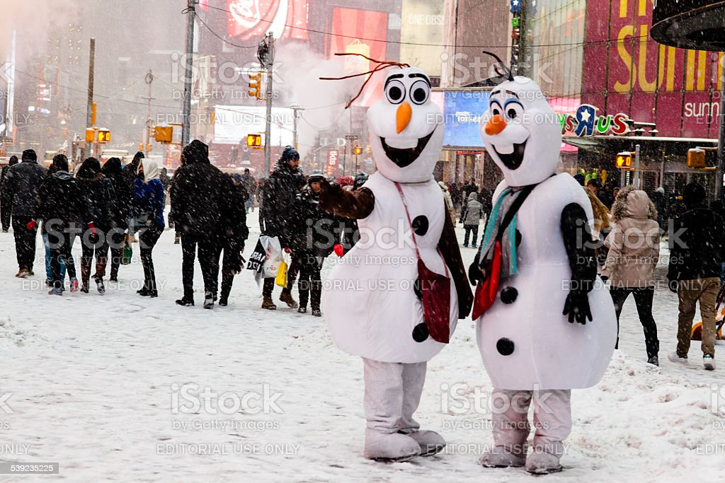 Times Square costumed characters. Olaf from Disney's Frozen. NYC Snow royalty-free stock photo