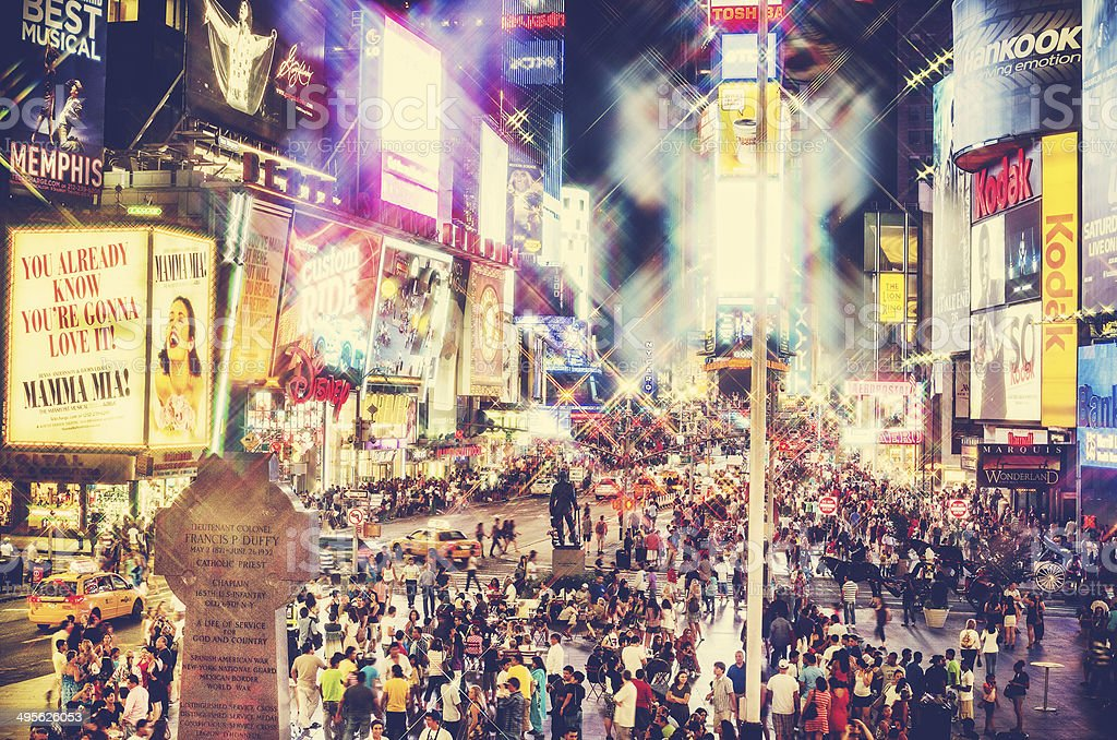times square crowd and billboard stock photo