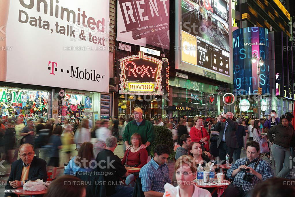 Times Square crowds and advertising billboards stock photo