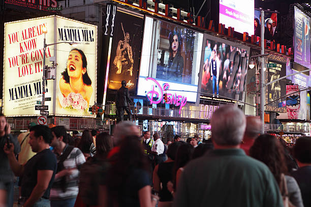 times square crowds and theater district billboards - mamma mia stock photos and pictures