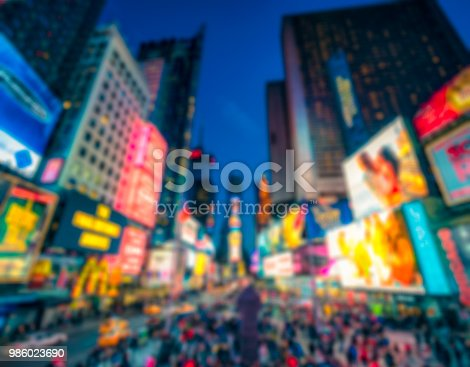 981808424 istock photo Times Square defocused at dusk 986023690