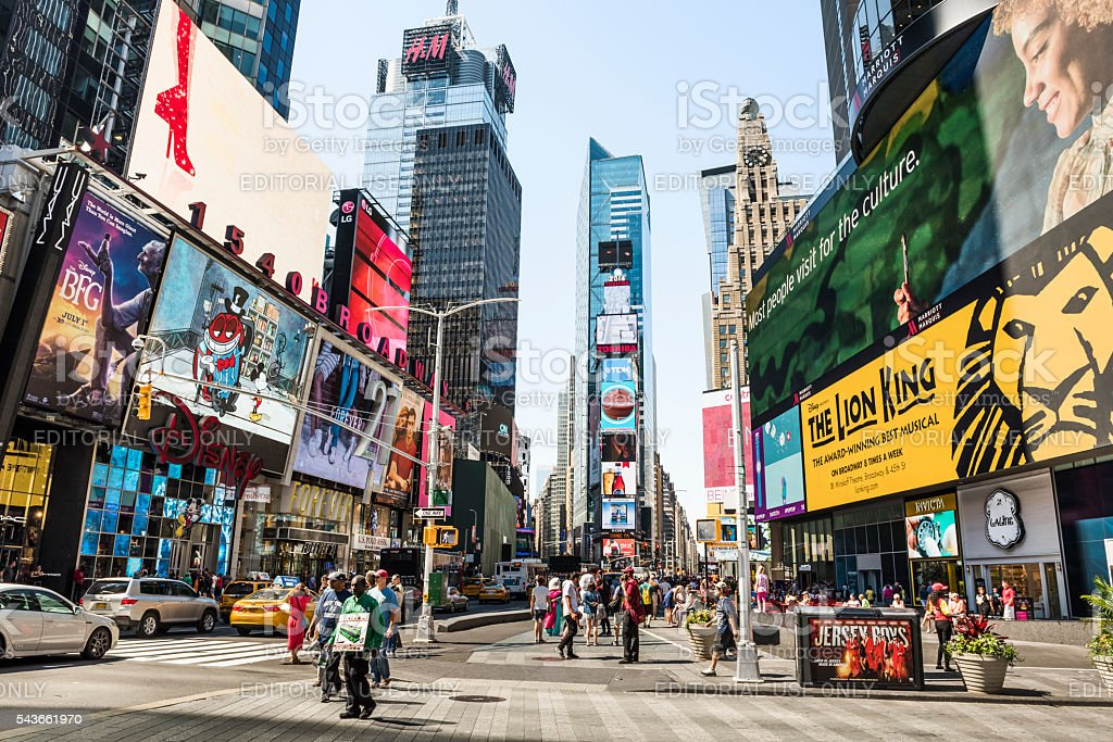 Times Square during the day with advertisements stock photo
