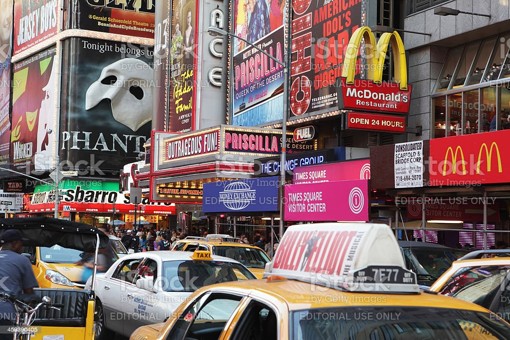 Times Square evening taxi cabs and theater district billboards royalty-free stock photo