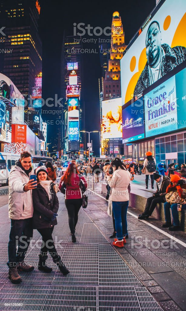 Times Square, featured with Broadway Theaters and animated colorful LED signs, stores, and lots of tourists and locals, is a symbol of NYC and the USA in Manhattan. stock photo