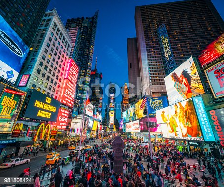 981808424 istock photo Times Square in New York City at dusk 981808424