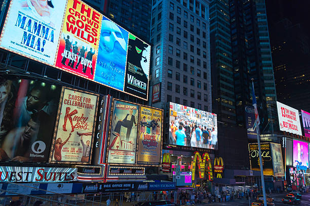 times square manhattan at night - mamma mia stock photos and pictures
