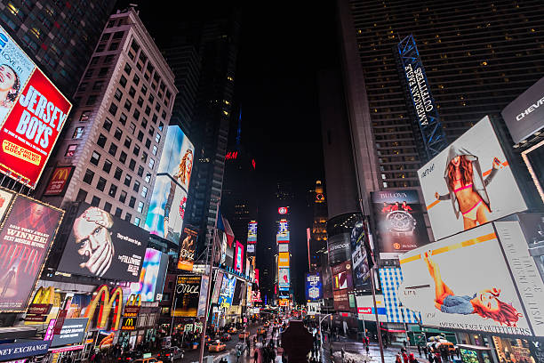 times square new york city at night - times square stock photos and pictures