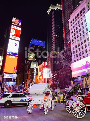981808424 istock photo Times Square, New York City, night scene 1203387769