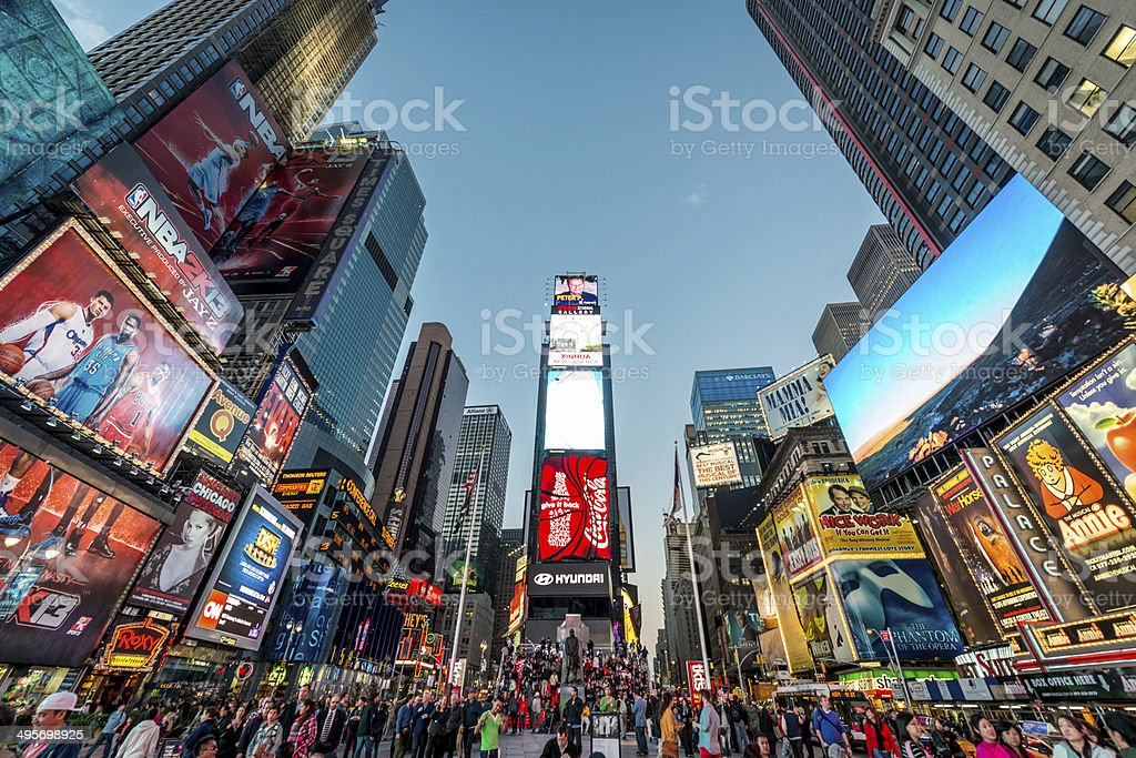 Times Square New York City Crowded Times Square at Twilight in New York City, USA. Activity Stock Photo