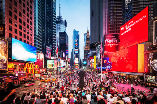 Crowded Times Square at Twilight in New York City, USA.