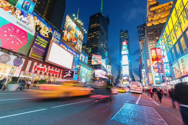 times square new york city taxi traffic - times square stock photos and pictures
