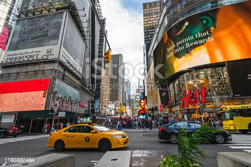 981808424 istock photo Times Square, New York City. Traffic, Taxi Car, Street View, Neon Art, Billboards, and Tourists 1160332494