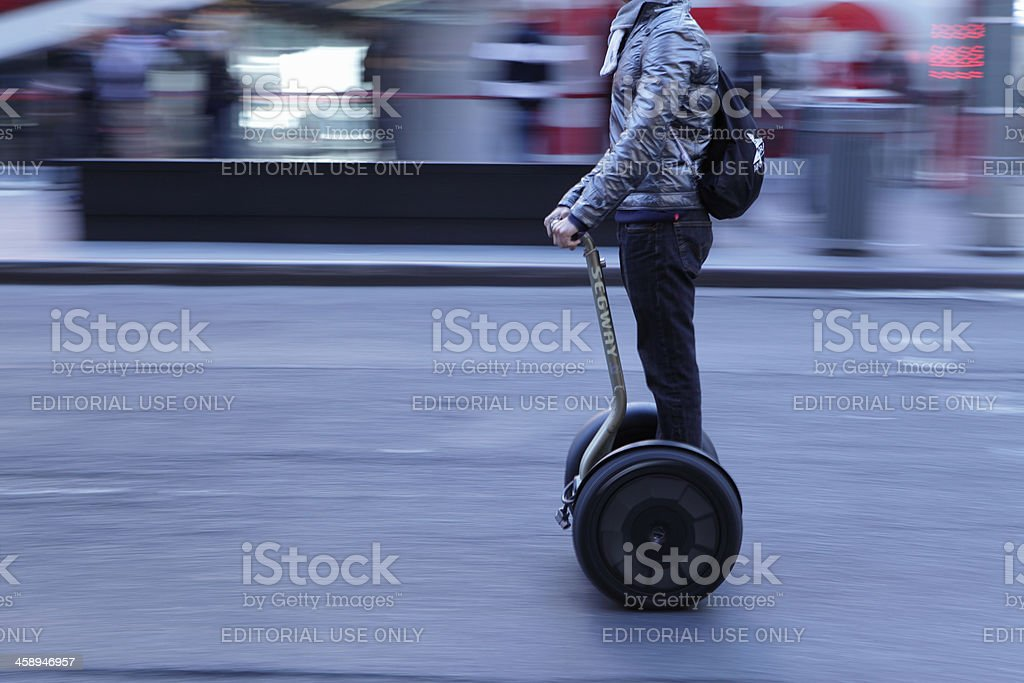 Times Square NYC man on Segway speeding stock photo