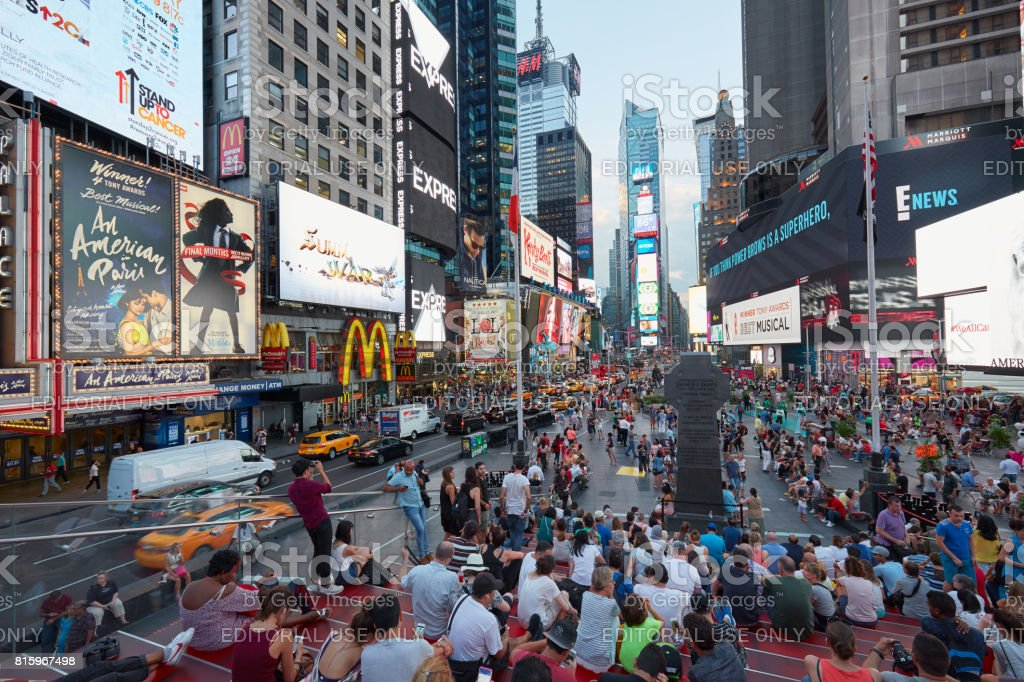 Times Square view with people from tkts bleacher seats in the evening in New York stock photo