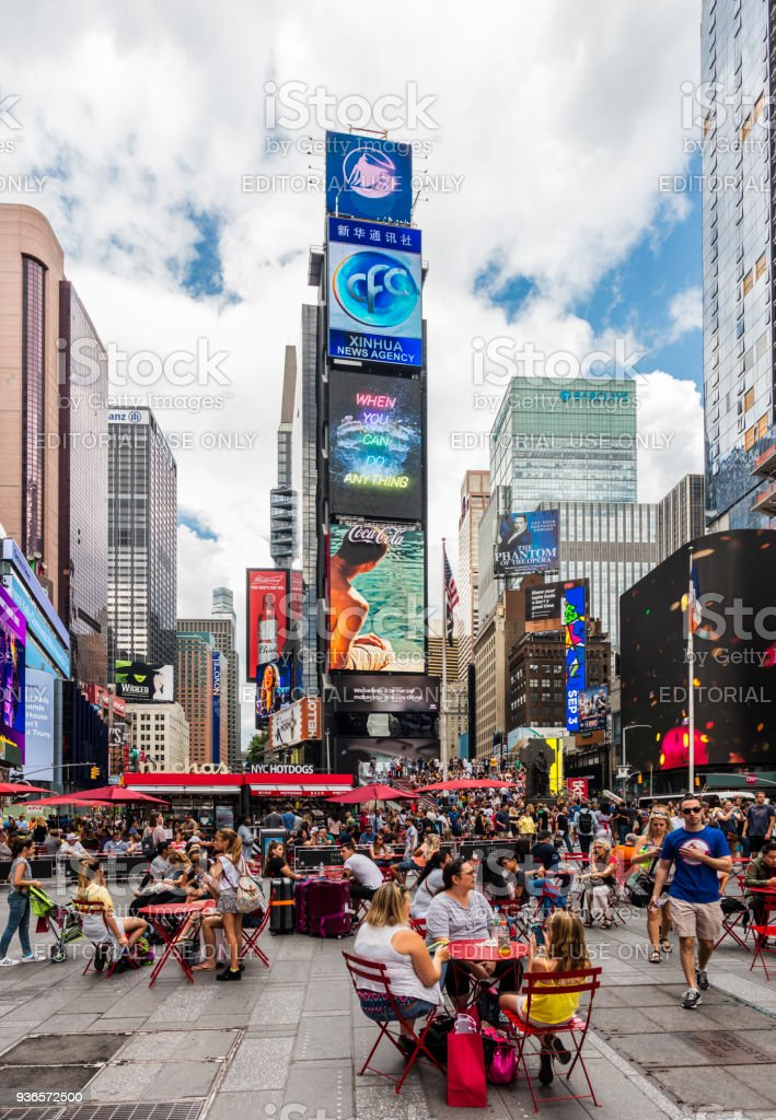 Times Square (Midtown Manhattan), with people, and customers sitting at the tables of an outdoor bar stock photo