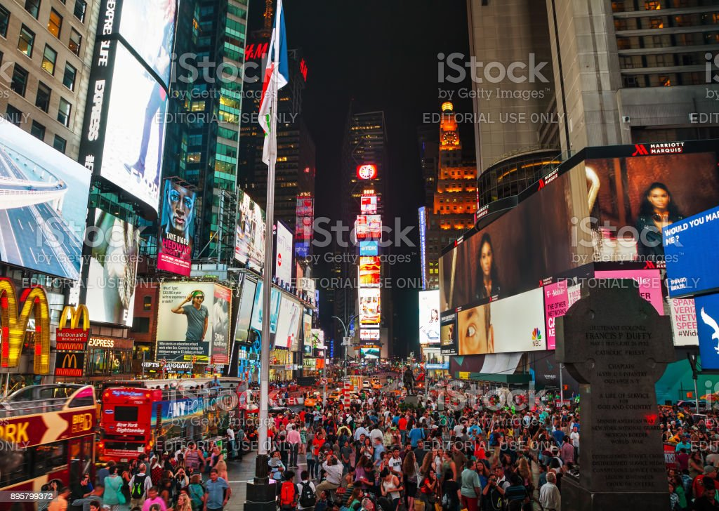 Times square with people in the night stock photo