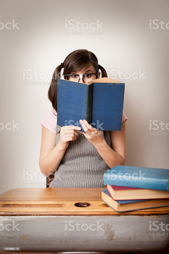 Timid, Nerdy Young Woman Student Peeking from Behind Book - Royalty-free 20-29 Years Stock Photo