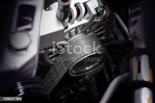 Timing belt of alternator in engine room of car, automotive part concept.