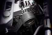 Timing belt of alternator in engine room of car, automotive part concept.