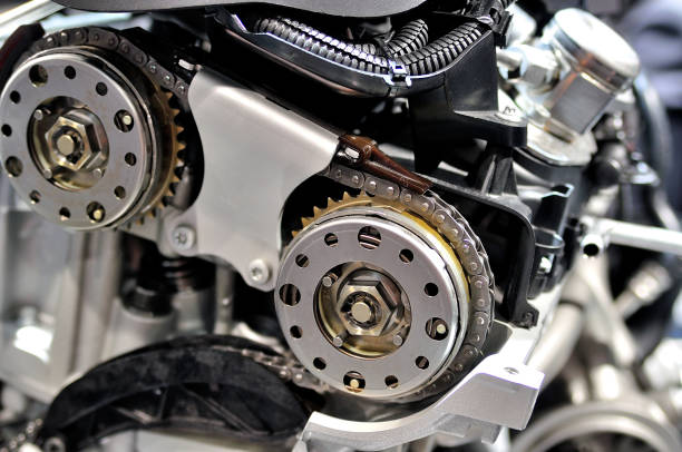 Timing chain on a gears from a car engine. Timing chain on a gears from a car engine. timer stock pictures, royalty-free photos & images